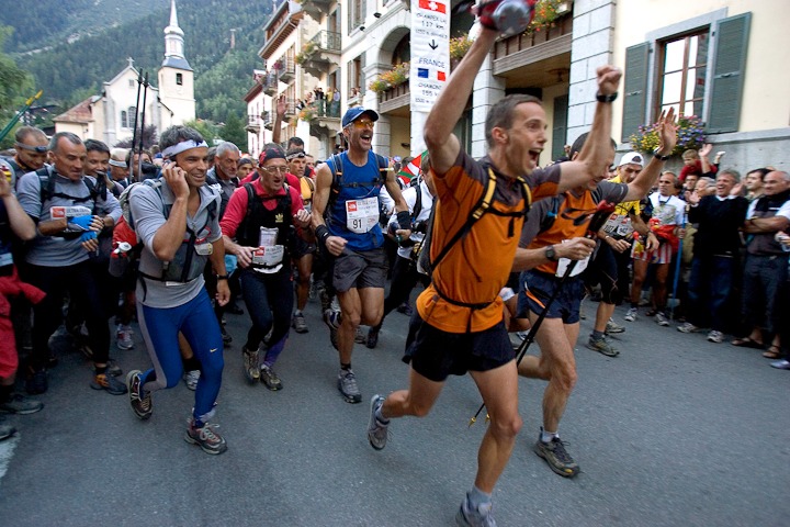 """Toph in full """"Charge"""" mode at the start of the Ultra Tour du Mont Blanc. Note Italian on cellphone"""