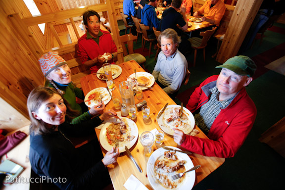 Lou (in red) enjoys a meal in the Wiesbadener Hut, Silvretta Tour