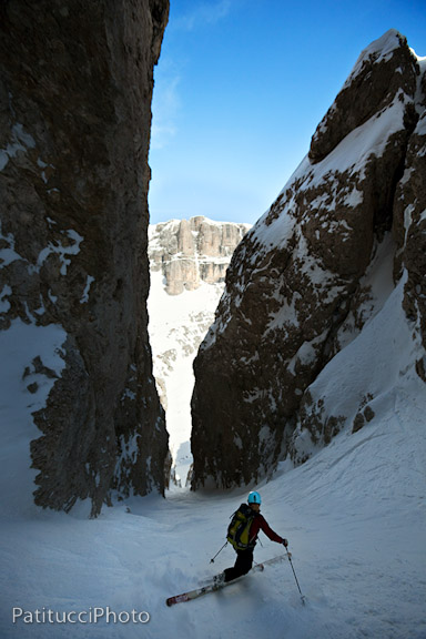 Susie Sutphin dropping into the Holzer Couloir, note the ski line, straight down