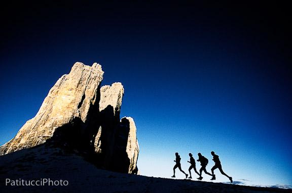 Trail runners in profile at the Tre Cime di Lavaredo