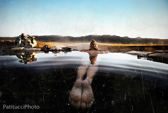Woman sitting in hot spring
