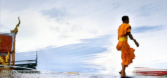 Buddhist monk's reflection in water